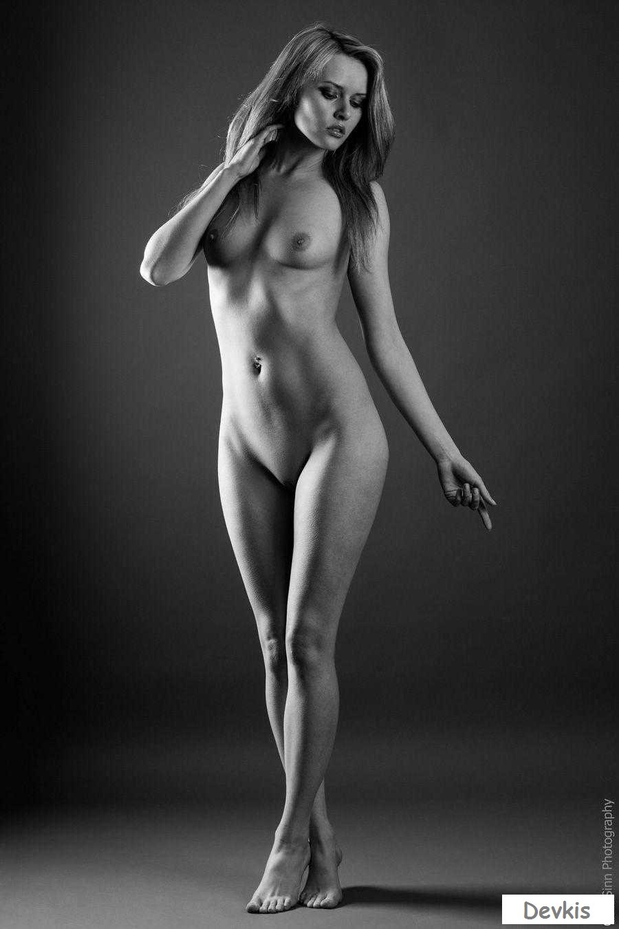 Teen with delightful titties strips and proudly shows her nude body